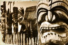 Guard and protect - Fierce looking tiki (ki'i) watch over Hale o Keawe on the big island of Hawaii.  Built around 1700 AD, the Heiau served as a sacred temple on the grounds and eventually housed the bones of 23 high chiefs. A number of the ki'i that surround the Hale o Keawe are solitary gods that safeguard the beach looking out to the ocean for kapu breakers, while the extensively decorated and more fearsome ki'i hover patiently at the heaiu.