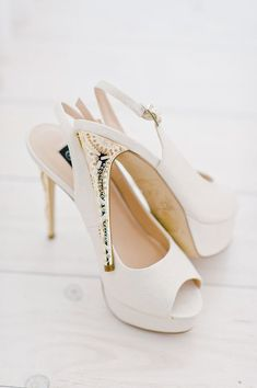 White open toe sling backs with gold heels