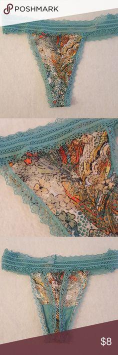 Vs thong Victoria's secret lacie thong. Blue/multicolored thong. NWOT medium Victoria's Secret Intimates & Sleepwear Panties