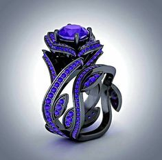 Maleficent inspired ring that I really want as a wedding ring. More than most others I've pinned because BLACK GOLD!