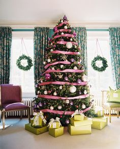 Gifts wrapped in lime green pop against a fir decked in pink and silver!  Designed by Eileen Kathryn Boyd