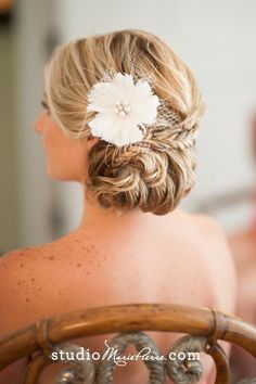 Bridal hair | I'm really digging the updos with braids in them, also curls, and DEFINITELY with the flowers. You know me.