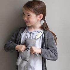 Menswear crafts-- crafts such as drawstring pouches, a patchwork throw blanket, girl's shirt dress, cat's mouse toy, and a stuffed bunny made from old shirts