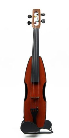 NEW from the Magic Fluke company!  The design was inspired by the 17th century Dance Master's Violin or Pochette, a very narrow bodied instrument played by traveling dance instructors and sized to fit in a pocket.  Just like Magic Fluke's renowned Fluke, Flea and Firefly ukuleles, it shares the same distinctive design and quality features. The Cricket is a full-scale violin, versatile enough to satisfy seasoned violin and fiddle players looking for an affordable, durable travel instrument as…
