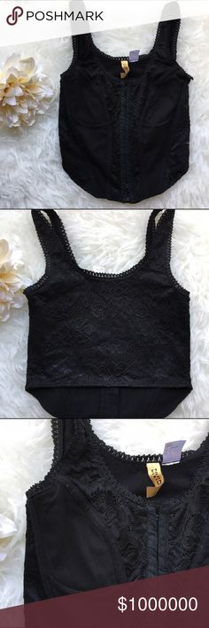 Black lace crop top 💥Discounted Bundles💥 ▪️Please use the offer feature 👍🏽 ▪️Ships within 24 hours ✈️ ▪️🚫No trades🚫No Paypal 🚫Holds ▪️ Love the item but not the price?  Make an offer! 😊 ▪️Questions?  Don't be shy!  Feel free to ask 💁🏽 ▪️Condition - NWOT ▪️Size - 2 ▪Description -  Beautiful corset inspired crop top with hook closures along the front.  Pretty lace detail.  Excellent condition! H&M Tops Crop Tops