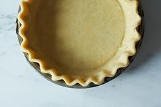 """Cook's Illustrated Foolproof Pie Crust  I have been using this recipe for years for large and small pies and tartlettes.  It is the best!  100% butter for the French tarts.  I keep a bottle of vodka in the frige and 1"""" cubes of butter to equal a recipe amount in the freezer.  Frozen butter makes the crust flaky."""