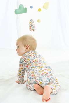 Our prettily patterned sets can be worn as playtime-friendly daywear or cosy nightwear. The pack includes two sets to choose between – perfect for dealing with unexpected spills. Its supersoft fabric is kind to newborn skin, while the itch-free metallic thread adds a sparkly touch.