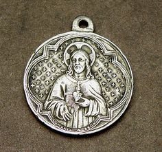 A beautiful antique silver plate Sacred Heart holy medal with the Sacred Heart Basilica on the reverse.  Medal measures approximately 1/2 wide x