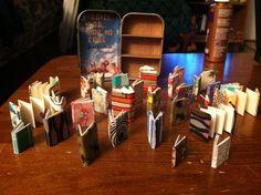 Suitcase altoid tin full of inch tall tiny books.