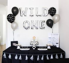 WILD ONE | Leos first birthday party decor! Thank you to all of our family & friends who came out to celebrate our little wild one turning 1! . Amazing treats by the talented @panda_cakes__ | Black table linen @mv_decor #firstbirthday #birthdayparty #leocristiano #oneyearold #blackandwhite #monochrome #monochromatic #birthdaydecor #partydecor #styleinspo #modernmom #ohheymama #vancouvermom #vancitybloggers #vancity #follow #ig_motherhood #igkids #motherhoodthroughinstagram #momlife… Boys 1st Birthday Party Ideas, Wild One Birthday Party, Baby First Birthday, 1st Boy Birthday, First Birthday Parties, Panda Birthday Cake, Simple Birthday Decorations, Black Party Decorations, Cake Table Birthday