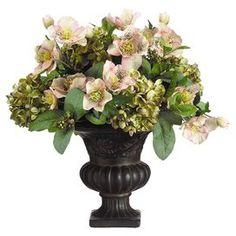 "Add an organic touch to your entryway console table or kitchen counter with this lovely faux hydrangea and hellebore arrangement, nestled in a Victorian-inspired urn.  Product: Faux floral arrangementConstruction Material: Resin and fabricColor: Green and roseFeatures: Includes faux hydrangeas and helleboreDimensions: 21"" H x 16"" Diameter"