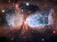 The bipolar star-forming region, called Sharpless 2-106, or S106 for short, looks like a soaring, celestial snow angel.