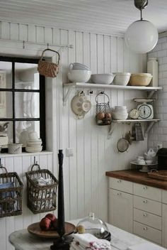 Open shelves with ironstone bowls on bead board walls...love