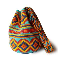 $49.90-$52.90 #Wayuubags. These double thread small mochila bag are perfect for carrying around a few items such as your phone, wallet and a few other necessities. They also make a very cute gift for younger women and young girls. The colors of these mochilas Wayuu are inspired by the vivid colors that surround region of La Guajira. All Wayuu bags come with a handwritten postcard, and little gift. The time required to elaborate a Wayuu Mochila varies from 4-7 days. www.lombiaandco.com Form Crochet, Crochet Woman, Knit Crochet, Gifts For Young Women, Tapestry Crochet Patterns, Origami Bag, Tapestry Bag, Art Bag, Little Gifts