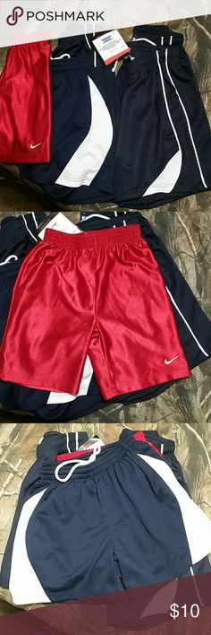 Pile of Kid's Shorts EUC & 1 NWT kid's athletic shorts- Red Nike's Size 4- Navy w/the thicker White Stripe Girl's Large- 3 identical Navy/White shorts Size Youth XL 2 EUC & 1 NWT  They are pretty much all the same & fit the same Bottoms Shorts