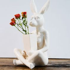 The Tabletop Collection by Gillie and Marc  For their newest collection, the artists turned their hands to ceramics for the first time. Their iconic characters, Dogman and Rabbitgirl, have now been turned into pieces of fine functional art. These pieces are sculptural vases, which have been specifically made to be used and loved. In minimalist white, these artworks have been created, crafted and designed to bring an artful touch to any home or office - in a completely unexpected way!