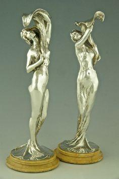 Art Nouveau candelabra sculptures.