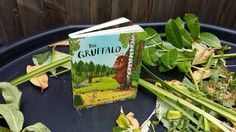 Gruffalo tuff spot for a gruffalo party theme. I put the pictures of the characters from the book on cardboard and hid them amongst leaves, twigs, logs and flowers and put a hardboard copy of the book in as well.