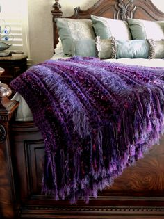 "Crochet throw - Finally finished!  I started out using left over yarns but of course needed to buy more and now have enough for another one! hehe!. All done in single crochet, I used Sashay (scarf yarn), Bernat Boa eyelash, Homespun Grape, Loops & Threads fabulous fur as well as a L&T sequin yarn to trim. Unfortunately the metallic from the Sashay doesn't show in the photo. (throw is folded in half showing double 9"" fringe) I love these chunky, soft and easy throws!"