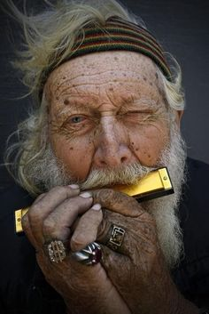 Music anywhere you go… Old man - at least older than many! - with white beard in a drab color photograph with poor light, no backlighting - which makes this a GREAT PHOTOGRAPHY COMPOSITION by making the GOLDEN Harmonica stand out! - DdO:) - http://www.pinterest.com/DianaDeeOsborne/instruments-for-joy/ - INSTRUMENTS FOR JOY, a wind instrument pinned via margheri.