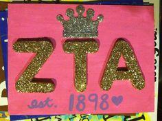 ZTA glittered wood letters mod podged onto canvas.
