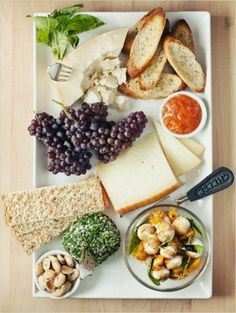 Summery cheese plate: manchego with apricot jam, chevre with herbs, parmigiano reggiano with honey,and baby mozzarella cheese with tomatoes, basil, and a balsamic vinaigrette. Add marcona almonds, fresh grapes or figs, crostinis, and seeded crackers.