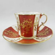 Beautiful tea cup and saucer set, red with gold flowers and gold trimming on cup and saucer edges. This piece was made in England by Hammersley and Co. Excellent condition (see photos). Markings read: Bone China Hammersley & Co Made in England Please bear in mind that these are