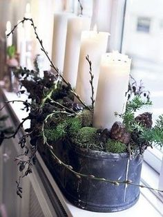 A rustic Christmas window display...maybe in terra cotta pots too!
