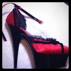 ❤️SALE!!!!❤️ Pleaser red and black high heel shoes This pair of Pleaser brand dancer's heels is absolutely gorgeous! The shoe features an impressive 5 inch heel and lovely black lace accenting the bright, eye-catching red color. Red and black are a timeless and sexy combination! Unfortunately, they were a gift from an ex and are three sizes too big for me. I need a size 3 shoe, and it's hard to find nice shoes in my size. They've barely been worn at all. I'm clumsy in heels, and these are…