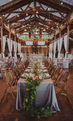 Rustic wedding reception decor - long, rectangle tables with greenery garland {A. Renee Weddings & Events}