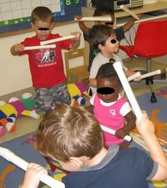 Gross Motor Batons in Action - - Pinned by #PediaStaff.  Visit http://ht.ly/63sNt for all our pediatric therapy pins