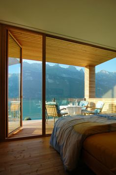 Beautiful room with view of lake and mountains.