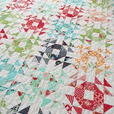And a close up of our quilt, Modern Vintage. This is a scrappy quilt made from two Layer Cakes, one Daysail and one Hello Darling. The pattern for this is in the same August issue of APQ. Oh, and @alatimer quilted this, of course! My mom @bonniecottonway and I are still working on who gets to keep this one. Maybe we'll have to cut it in half? ;-)