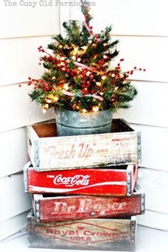 Farmhouse Christmas Vintage Decor - old quot; crates stacked to hold tiny tree - A Farmhouse Christmas - The Cottage MarketVintage Decor - old quot; crates stacked to hold tiny tree - A Farmhouse Christmas - The Cottage Market Christmas Porch, Noel Christmas, Merry Little Christmas, Outdoor Christmas Decorations, Country Christmas, All Things Christmas, Winter Christmas, Christmas Crafts, Primitive Christmas