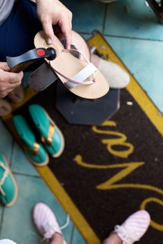 Amanda told us that she had custom sandals made at a place called Nana, so we obviously had to explore that. It was so great! I got to pick out the style sandal I wanted along with the color leather and the shoemaker sized it to my foot exactly and made the shoes right there in front of us!- #MeetTheMindells: Our Honeymoon in Positano | Studio DIY®