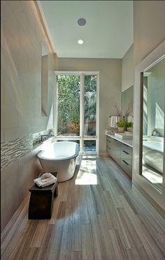 Travertine wood look bathroom floor. I would shower here thank you.