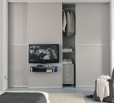 contemporary sliding door wardrobe with TV screen integrated 305 zemma srl