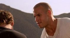 In the movie, The Fast and the Furious (2001), When Brian (Paul Walker) saves Vince (Matt Schulze) from the semi, his identity as a cop is revealed.