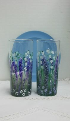 """Hand painted lavender garden, with lily of the valley, water glasses. They were hand painted using acrylic enamel paint and then heat set. Anchor Hocking glass. The glasses are 7"""" tall and hold 15 oz. Hand washing recommended. priced ea. Lavender Garden, Lavender Flowers, Paint And Drink, Garden Painting, Scandinavian Art, Enamel Paint, Lily Of The Valley, Folk Art, Glass Art"""
