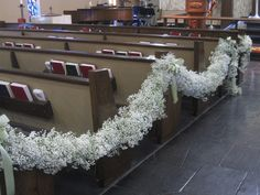 Babys Breath Garland - love this, but used to line the floor of each side of the aisle instead of petals and no bows