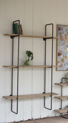 iShown in the Nut House makeover on Fixer Upper.ibrbrLight industrial tubular metal shows off plank wood extended shelves. These space savers come in small and large sizes and may be hun. Wall Shelving Systems, Wood Shelving Units, Wood Bookshelves, Pipe Shelving, Shelving Ideas, Wall Units, Wood Wall Shelf, Wooden Shelves, Glass Shelves