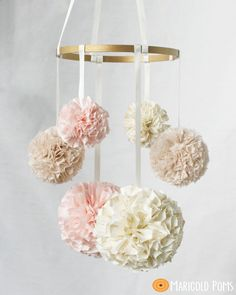 Nursery Mobile with Lace, Baby Mobile, Crib Mobile, Hanging Pom Poms, Nursery Decor, Pom Pom Mobile - Pink, Yellow fabric pom pom mobile by MarigoldPoms on Etsy https://www.etsy.com/listing/158577102/nursery-mobile-with-lace-baby-mobile