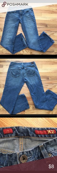 Express Jeans These are an older style of boot cut Express Jeans size 8 regular. They are gently used with signs of wear around the pockets and discolorations around the ankles on the back. There are no stains on them.  Price Firm. Express Jeans Boot Cut