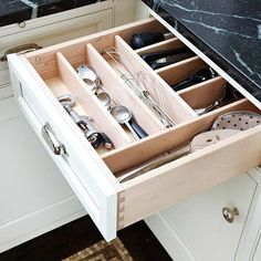 Organize Utensils  Drawer dividers provide specific slots for frequently used utensils. The drawer's placement next to the cooktop keeps necessary tools at the ready.