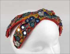 Bes-Ben 'Mirrored' hat | Made in Chicago, United States | Bandeau is entirely covered in red, blue, and green bugle beads, clear flower form beads, and multi-colored embroidered mirrored pieces