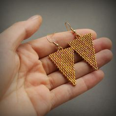 Beautiful triangle earrings. Geometric jewelry. Minimalist earrings. Earrings made of Japanese seed beads. Measurements: Length - 6 cm / 2.4 (including ear wires) Width - 2,5 cm / 2.5 More seed bead earrings from my shop you can see here: