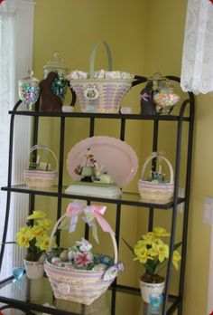 Longaberger Easter basket collection on wrought iron display shelving. Chocolate bunnies.