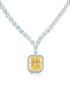 Tiffany & Co. pendant with a rectangular modified brilliant Fancy Intense Tiffany Yellow Diamond in 18ct gold and white diamonds in platinum, from the 2013 Blue Book Collection