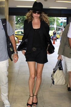 February 16 2011  She arrived at Rio de Janeiro airport wearing a black shorts suit on her way to a Vogue Brazil shoot with Mario Testino.