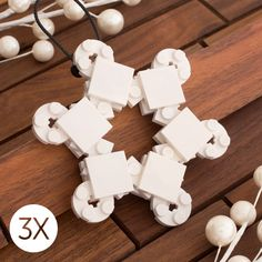 "A Lego Platecraft Ornament building kit custom designed by Chris McVeigh. 72 parts in total. Building instructions are available at http://chrismcveigh.com.  This kit makes three (3) small snowflake ornaments.   Weight: 9g/0.32oz; Diameter: 3.5""/8.25cm"
